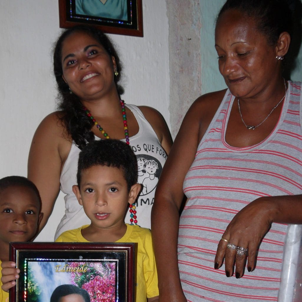One family shows the photo of their killed daughter and sister.