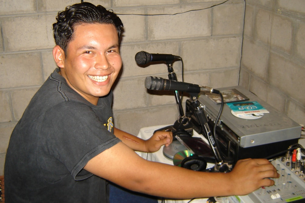 A young man makes local radio in Chalate.