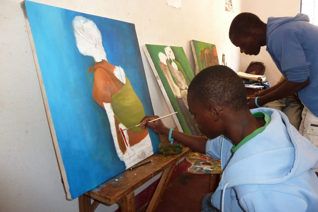 Young men painting