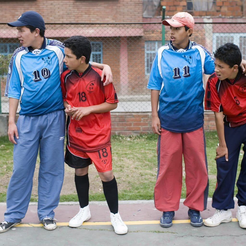 Young people from Colombia playing football together.