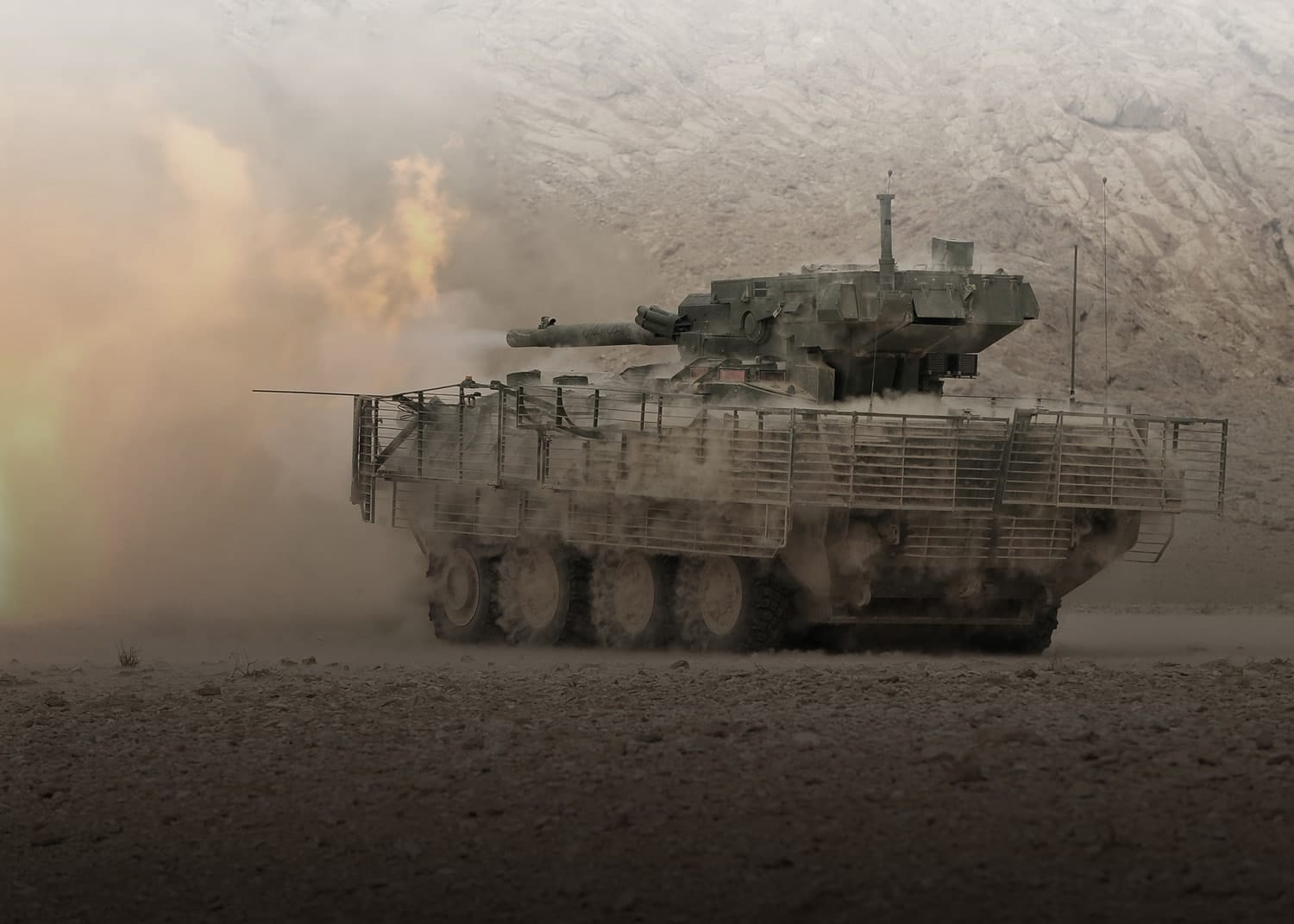 tank firing a volley in the dust