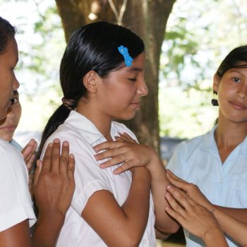Girls give each other confirmation in an Ee'qanil workshop.